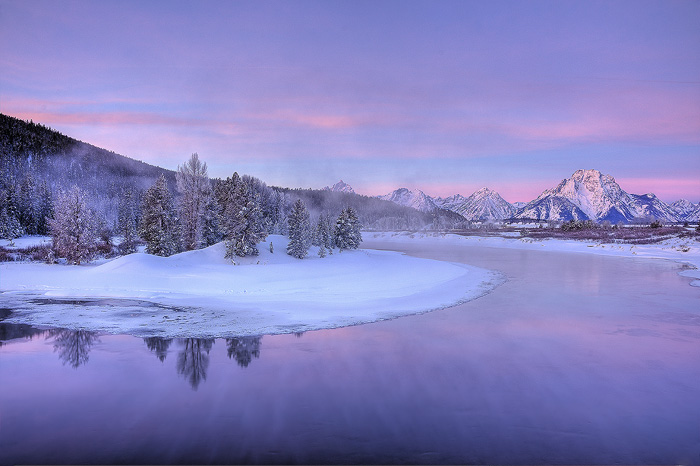 A pastel sunrise illuminates the Teton range over an unfrozen section of the Snake River.  Field Notes:   Sony a900 camera, Zeiss...